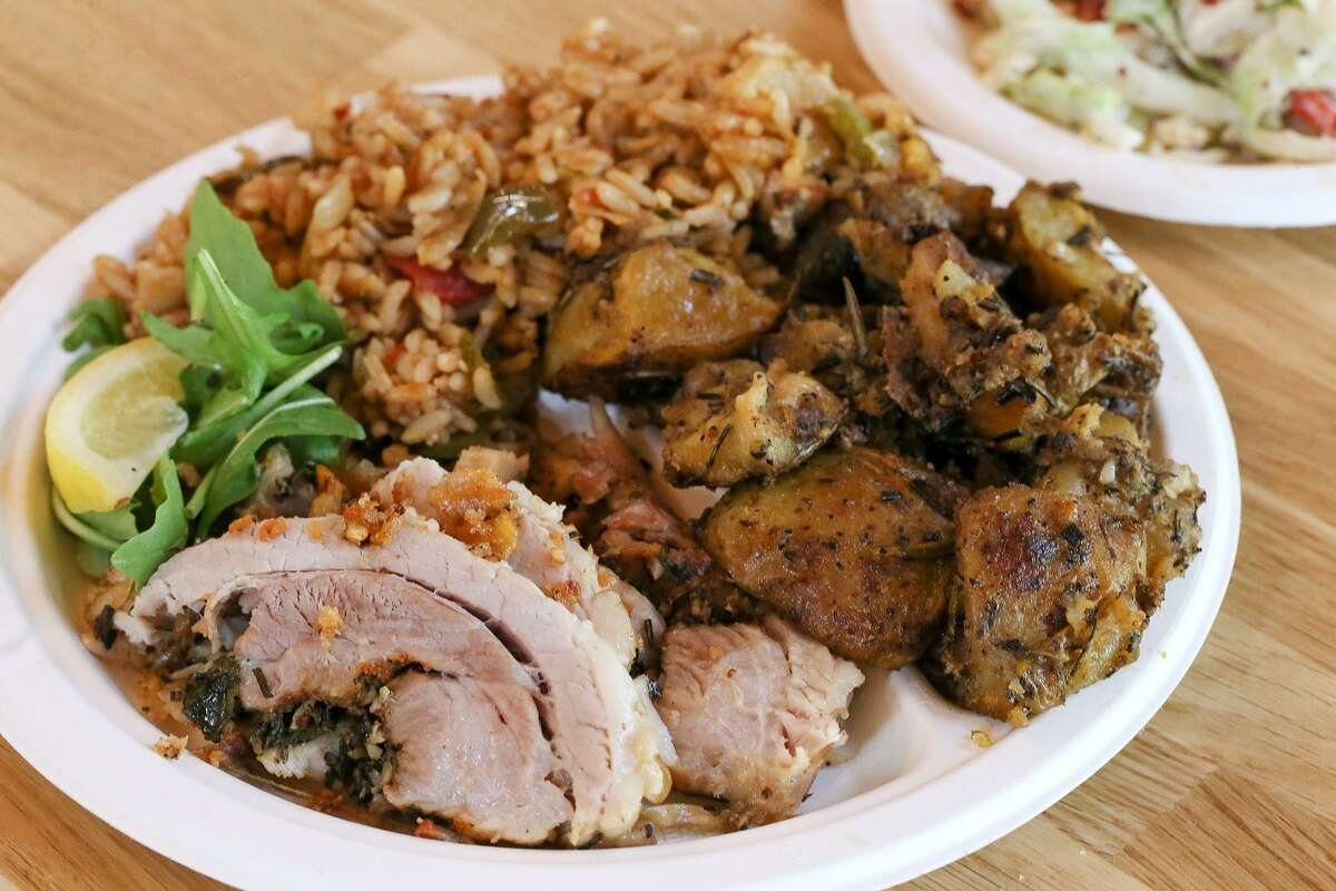 Louisiana-style porchetta with sides of Cajun jambalaya, roasted potatoes and cole slaw from Bud's Southern Rotisserie.
