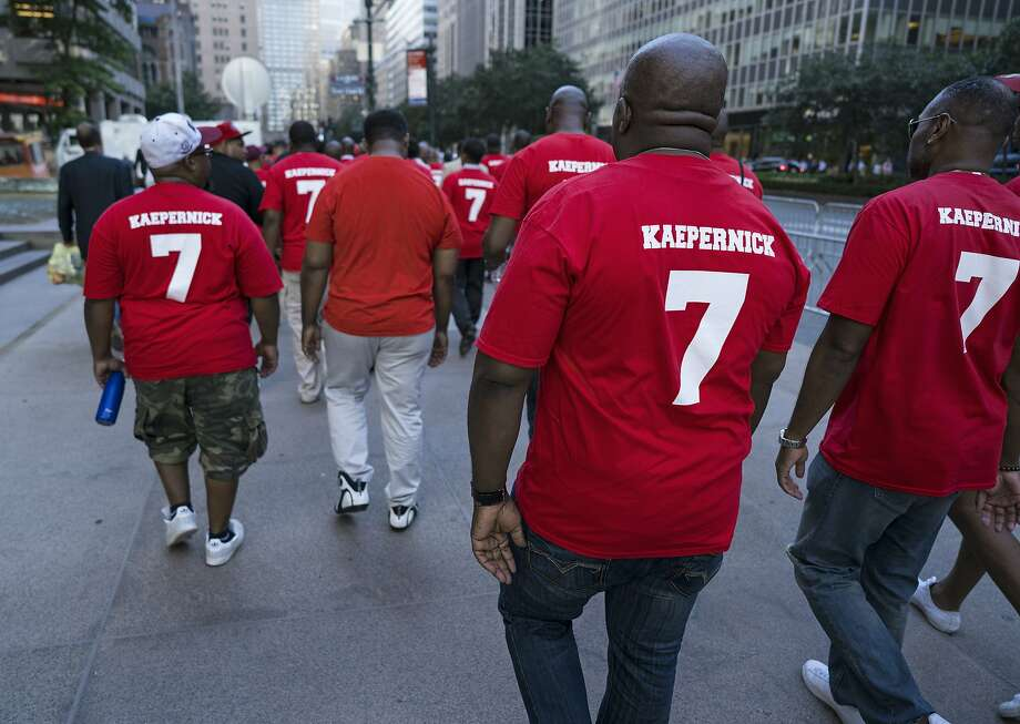 Supporters of unsigned NFL quarterback Colin Kaepernick, right, rallied Aug. 23 outside NFL headquarters in New York. Photo: Craig Ruttle, Associated Press