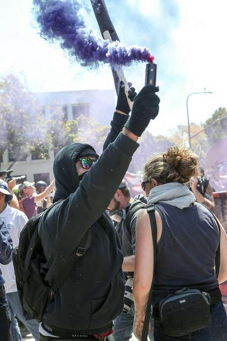 Antifa members and counter protesters gather at a rally. Photo: AMY OSBORNE, AFP/Getty Images