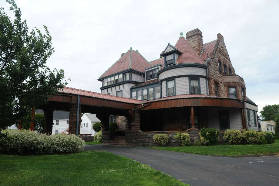 The 16,000-square-foot mansion on Hackett Circle has been divided into apartments since 1924. Two of the units, offering plenty of historic charm, are available to rent. Photo: Keelin Daly / Hearst Connecticut Media / Stamford Advocate