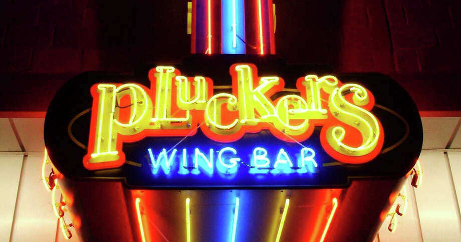 Austin-based Pluckers Wing Bar's sign near the University of Texas at Austin campus location. Photo: Courtesy Photo/Pluckers Wing Bar