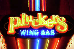 Austin-based Pluckers Wing Bar's sign near the University of Texas at Austin campus location.