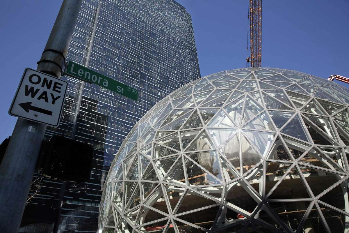 """Amazon plans to spend more than $5 billion to build another headquarters in North America to house as many as 50,000 employees. It will stay in its sprawling Seattle headquarters and the new space will be """"a full equal"""" of its current home."""