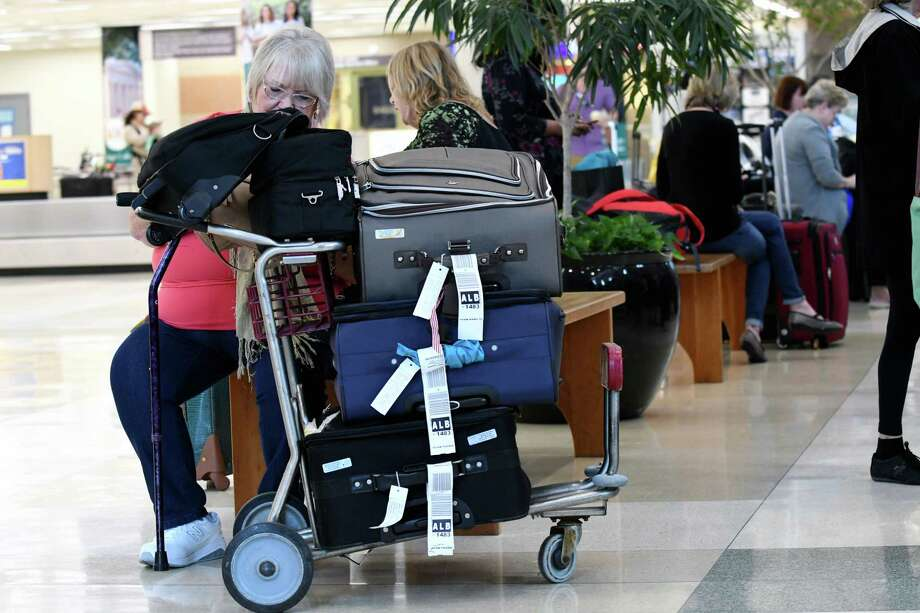 Marilyn Funk of Palmetto Fla. arrives at Albany International Airport after escaping from the impeding Hurricane Irma on Thursday, Sept. 7, 2017, in Colonie, N.Y. (Will Waldron/Times Union) Photo: Will Waldron, Albany Times Union / 40041493A