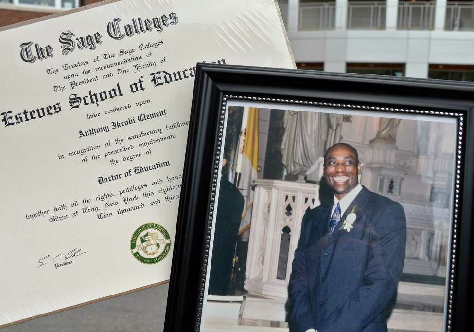 A family photo of the the late high school principal Tony Clement who was a hero to hard-up kids who struggled in school and his posthumously awarded Doctor of Education degree outside the Tony Clement Center for Education, Friday Sept. 1, 2017 in Albany, NY. (John Carl D'Annibale / Times Union)