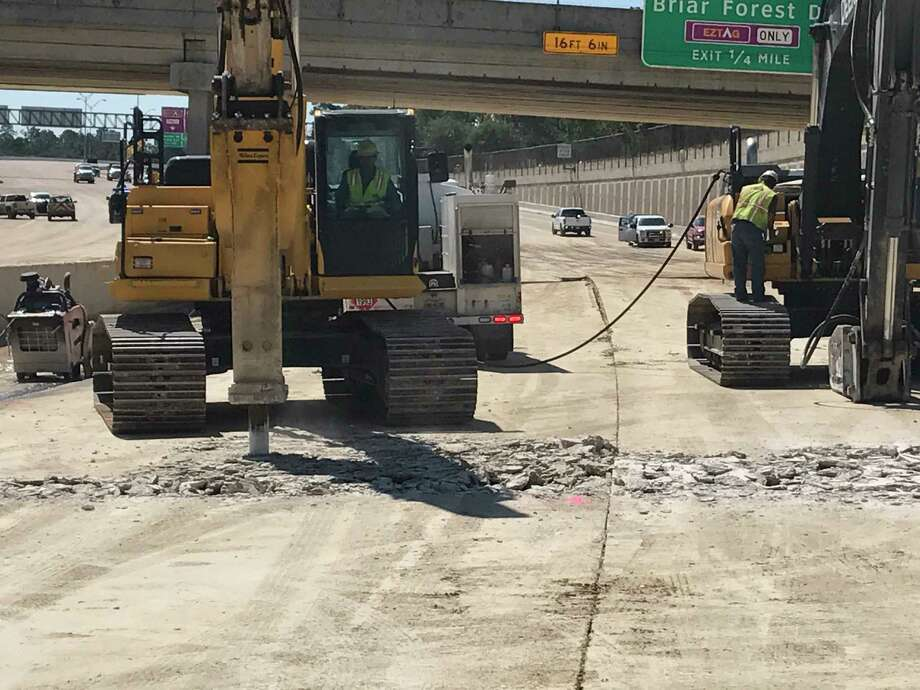 Buckled concrete along the Sam Houston Tollway near Boheme, south of Interstate 10, will keep the lanes closed at least for one week. Crews On Thursday, Sept. 7, 2017, began breaking up the lanes so the roadbed could be inspected. Photo: Dug Begley / Dug Begley
