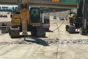 Buckled concrete along the Sam Houston Tollway near Boheme, south of Interstate 10, will keep the lanes closed at least for one week. Crews On Thursday, Sept. 7, 2017, began breaking up the lanes so the roadbed could be inspected.