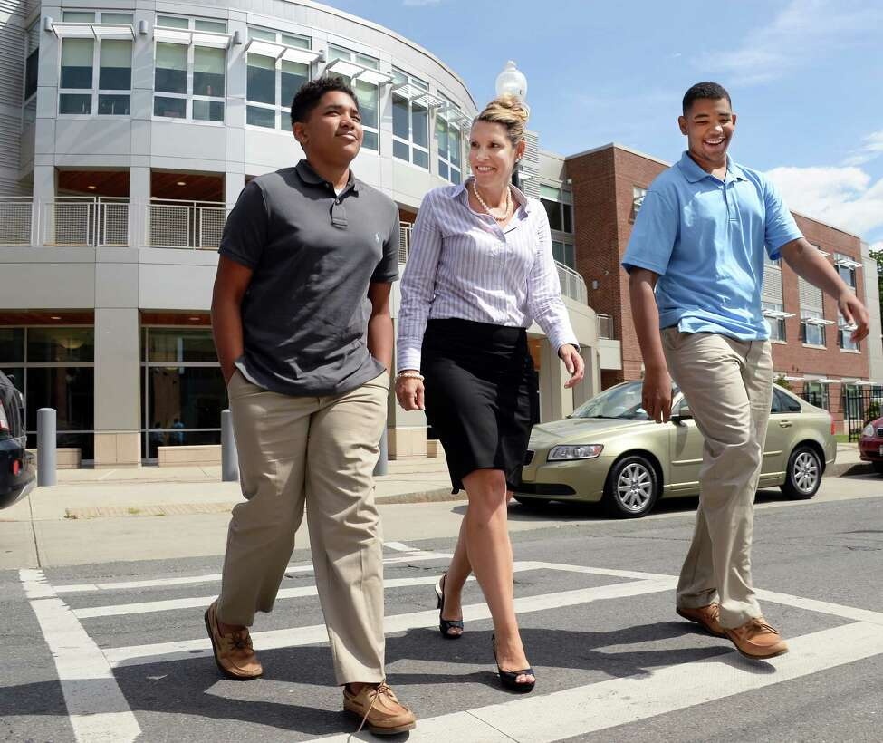Jennifer Clement walks with sons David, 12, left, and Anthony, 14 at the the Tony Clement Center for Education, Friday Sept. 1, 2017 in Albany, NY. (John Carl D'Annibale / Times Union)
