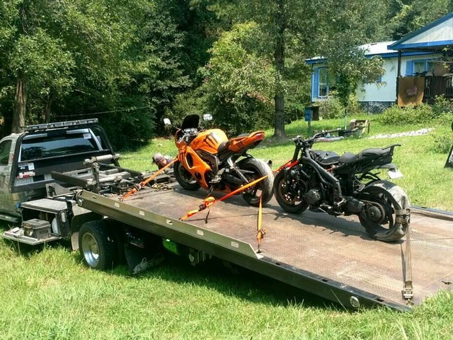 Deputies with the Precinct 5 Constable's Office executed a search warrant at a home in the 26800 block of Sea Turtle Lane in Magnolia on Wednesday, Sept. 6, 2017. While at the residence, the deputies located two stolen motorcycles and a stolen shotgun, authorities said. Photo: Submitted Photo