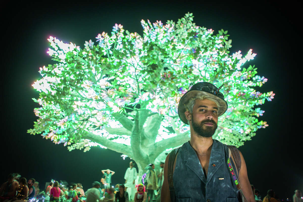 Raul Aragao from Brazil in front of the Tree of Ténéré at Burning Man 2017, the largest outdoor arts festival in North America, in the Black Rock desert of Gerlach, Nevada. (