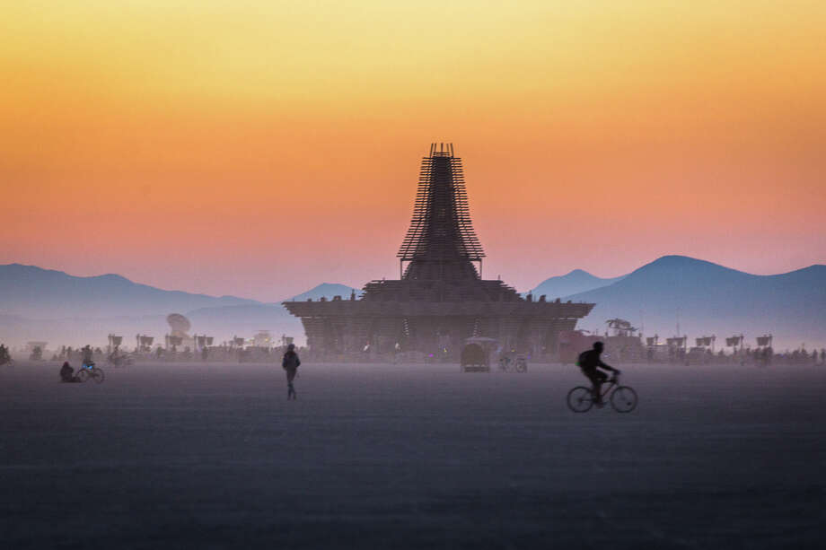 "Participants attend Burning Man 2017, the largest outdoor arts festival in North America, in the Black Rock desert of Gerlach, Nevada. (""Sidney Erthal works with the Burning Man Project as an archivist, photographer, and translator."") Click through the gallery for a roundup of celebrities and tech execs who attended the 2017 festival. Photo: Sidney Erthal / Burning Man"