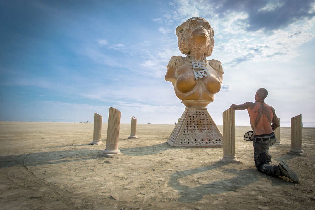 Trey Harvey, the son of Burning Man's Larry Harvey, takes in an artwork at Burning Man 2017, the largest outdoor arts festival in North America, in the Black Rock desert of Gerlach, Nevada. (