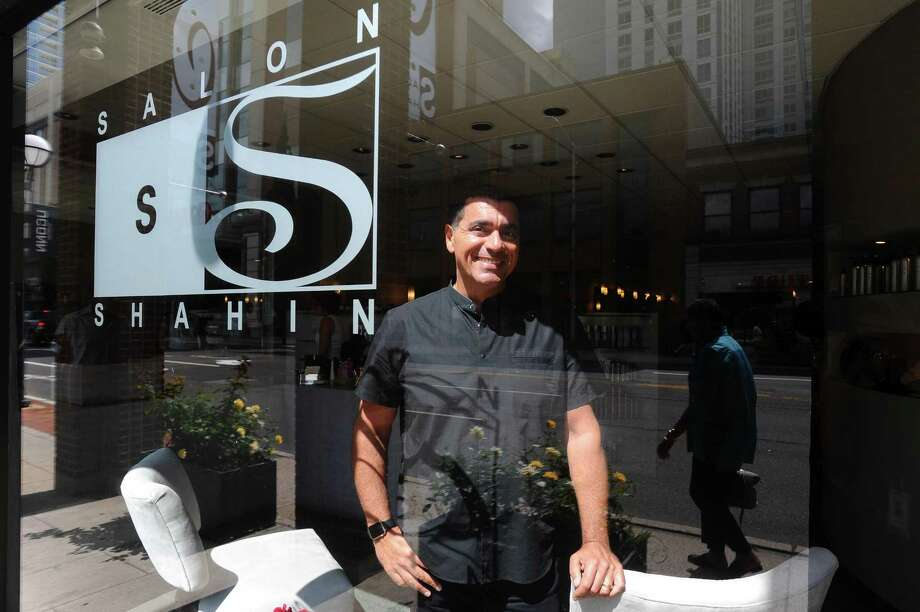 Salon Shahin owner Shahin Farzam poses for a photo inside his Broad Street salon in downtown Stamford, Conn., on Thursday, August 31, 2017. Photo: Michael Cummo / Hearst Connecticut Media / Stamford Advocate