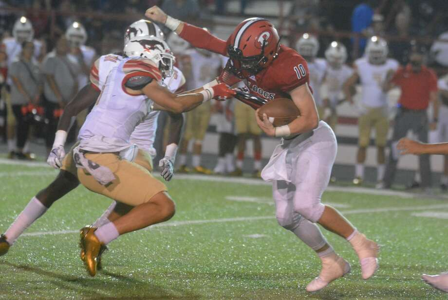 Plainview quarterback Carson Hauk, 10, tries to dodge a tackle by a Lubbock Coronado defender in the opening game of the season last week. The Bulldogs will face another strong foe when they travel to Amarillo to take on Tascosa Friday night. Photo: Skip Leon/Plainview Herald