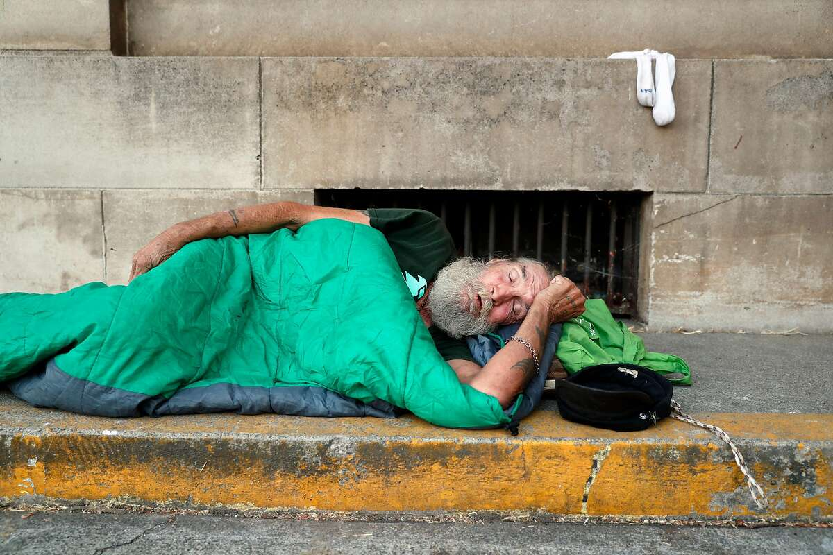 Homeless man, David Delo, 65, snoozes at his sleeping spot behind the Chico Post Office in Chico, Calif. on Wednesday, August 16, 2017.