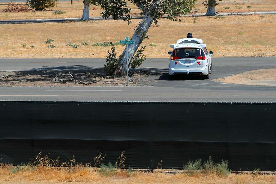 A Waymo autonomous minivan navigates the roads inside the former Castle Air Force Base in Merced County. The company can use its portion of the old base to recreate tricky driving situations it has already tested in a highly detailed simulator program. Photo: Michael Macor, The Chronicle