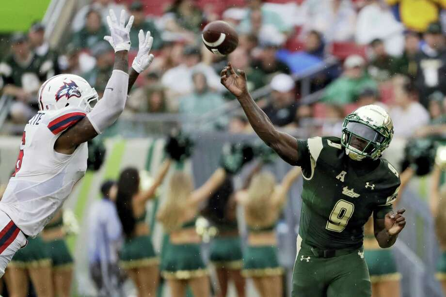 South Florida quarterback Quinton Flowers (9) passes as he is pressured by Stony Brook defensive back Tyrice Beverette during the first quarter Saturday  in Tampa, Fla. Photo: Chris O'Meara / The Associated Press / Copyright 2017 The Associated Press. All rights reserved.