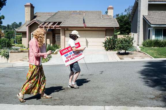 Democratic canvasser Ruth Richardson, left, and Betina Pavri, right, against Rep. Ed Royce in the 39th Congressional District, set out to knock on doors in a Brea neighborhood on August 26, 2017, in Orange County, Calif.