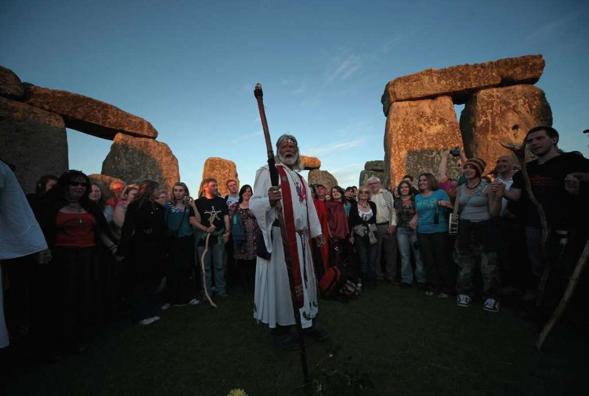 AMESBURY, ENGLAND - JUNE 20: Druid King Arthur Pendragon, conducts a Solstice sunset service as people gather in the megalithic monument of Stonehenge on June 20, 2010 on the edge of Salisbury Plain, west of Amesbury, England. Thousands of revellers began gathering for sunset at the 5,000 year old stone circle to see the sunrise on the following day, which is the longest day of the year in the Northern Hemisphere and is known as the Summer Solstice. (Photo by Matt Cardy/Getty Images) *** Local Caption *** Arthur Pendragon