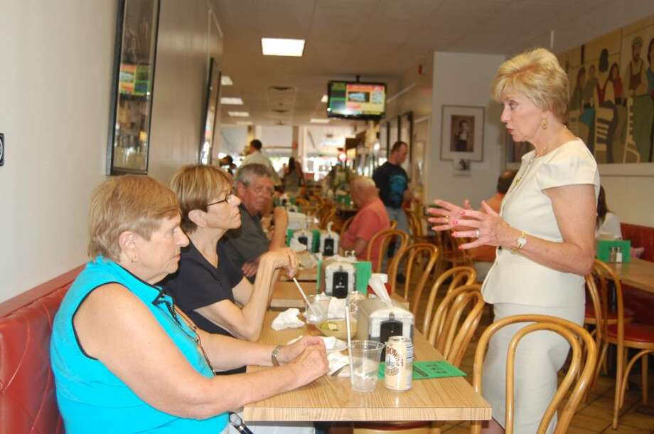 Republican U.S. Senate candidate Linda McMahon strolled through downtown Westport for a couple hours on Monday, chatting with shoppers and store employees about the economy, the local business scene and several other issues. Here, she discusses education policy with Evelyn Smick and Rozanne Lancia. Photo: Tim Loh / Westport News
