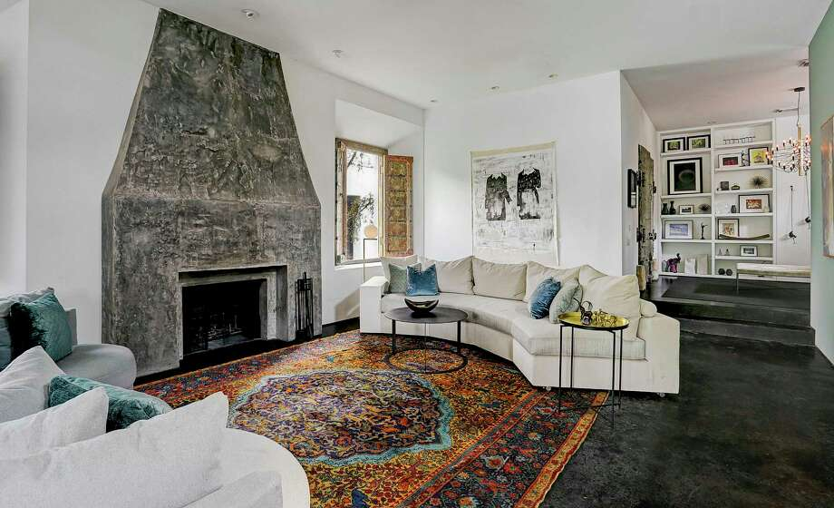 The Washington Heights home of Sicily Dickenson. Painting on the wall is by Houston artist Matt Messinger. Photo: Bill Krampitz