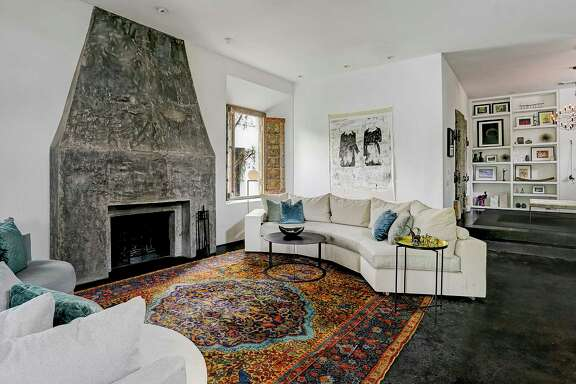 The Washington Heights home of Sicily Dickenson. Painting on the wall is by Houston artist Matt Messinger.