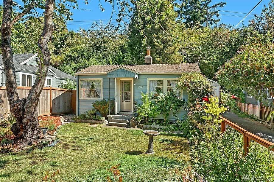 The first home, at 4722 26th Ave. S.W., is listed for $334,000. It is in Delridge.This cute home spans 590 square feet and has one bedroom and one bathroom. It was built in 1942 but the interior is delightfully modern. Don't forget to check out the beautifully landscaped -- and fully fenced -- backyard!There will be a showing for this home on Saturday, Sept. 9, and Sunday, Sept. 10, from 1 p.m. to 4 p.m. You can see the full listing here. Photo: Listing Courtesy Dawn Leverett, Windermere R.E. Wall St. Inc.