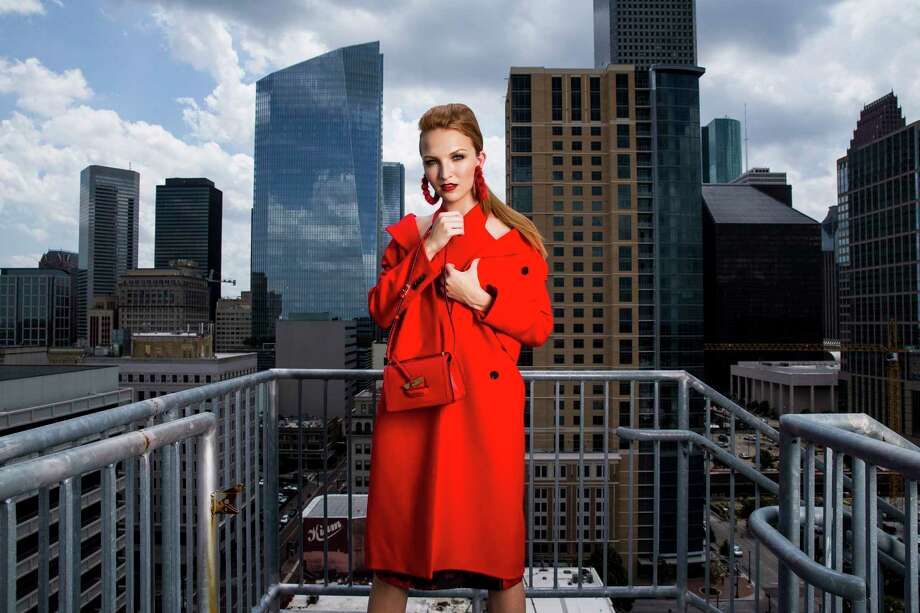 Bay Berger of Neal Hamil Agency is wearing a Balenciaga red coat, $2,959, from Neiman Marcus. A.L.C. top, $295, from Saks fifth avenue. floral skirt by Richard, $895, from Forty-Five Ten. Tom Ford platform sandals, $1,690, from Neiman Marcus. Ranjana khan earrings, $440, from Tootsies. Loewe handbag, $1,690, from  Saks Fifth Avenue. Fashion styling: Summar Salah. Makeup: Lisa Pelayo of VCI Artists. Hair: Dennis Clendennen of VCI Artists. Photo assistant: Dave Funchess.  Photo: Michael Ciaglo, Staff / Michael Ciaglo