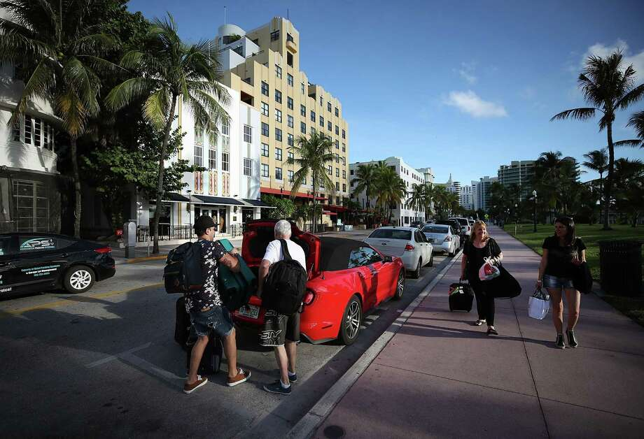 People prepare to leave Miami Beach, Fla. in advance of the approaching Hurricane Irma on September 7, 2017 in Miami Beach, Florida. Online travel giants Expedia and Priceline have been dealing with a flood of requests for reservation cancellations as a result of the storm, with some customers complaining about the service they have received. (Photo by Mark Wilson/Getty Images) Photo: Mark Wilson / Getty Images / 2017 Getty Images