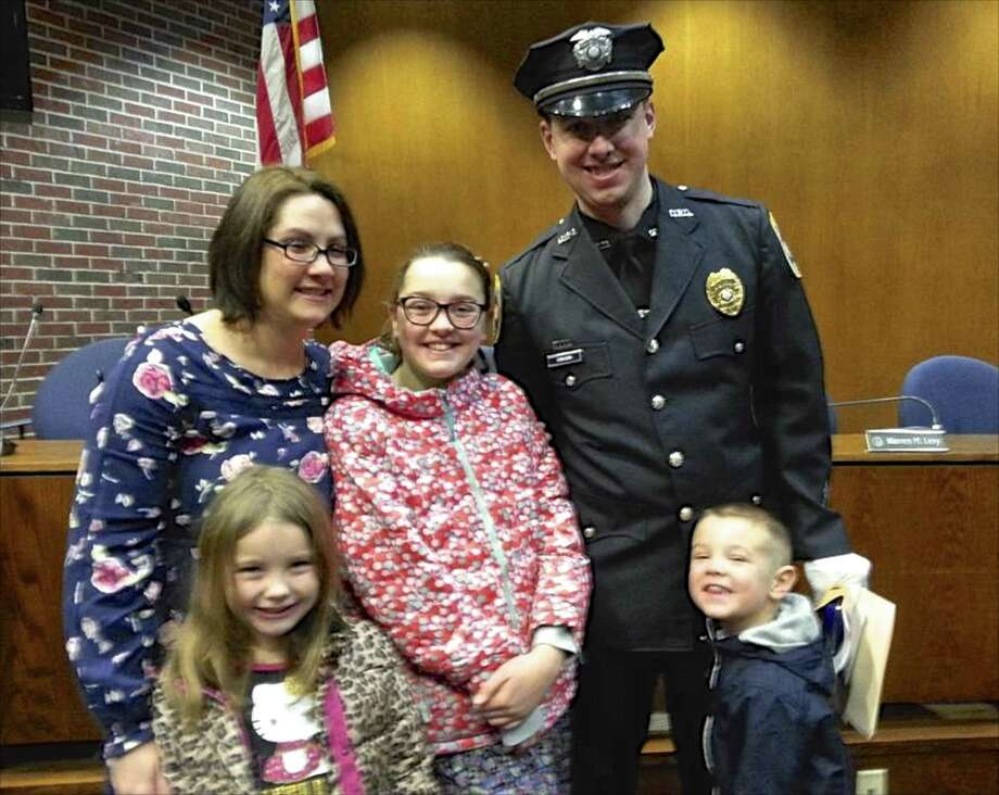 Danbury police Sgt. Drew Carlson with his wife, Erin and his children, from left, Taylor, Kayla and Tyler. Photo: Contributed Photo / The News-Times / The News-Times Contributed