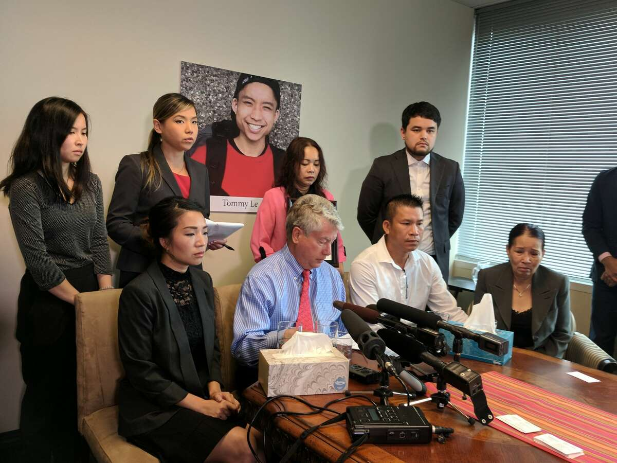 Tommy Le's family gathers with attorneys to announce a claim filed against the King County Sheriff's Office after a deputy killed him in June. Top, left to right: aunt Uyen Le, attorney Linda Tran, mother Dieu Ho, cousin Missouri Le. Bottom, left to right: cousin Xuyen Le, attorney Jeffrey Campiche, father Hoai Le and grandmother Kim Le.