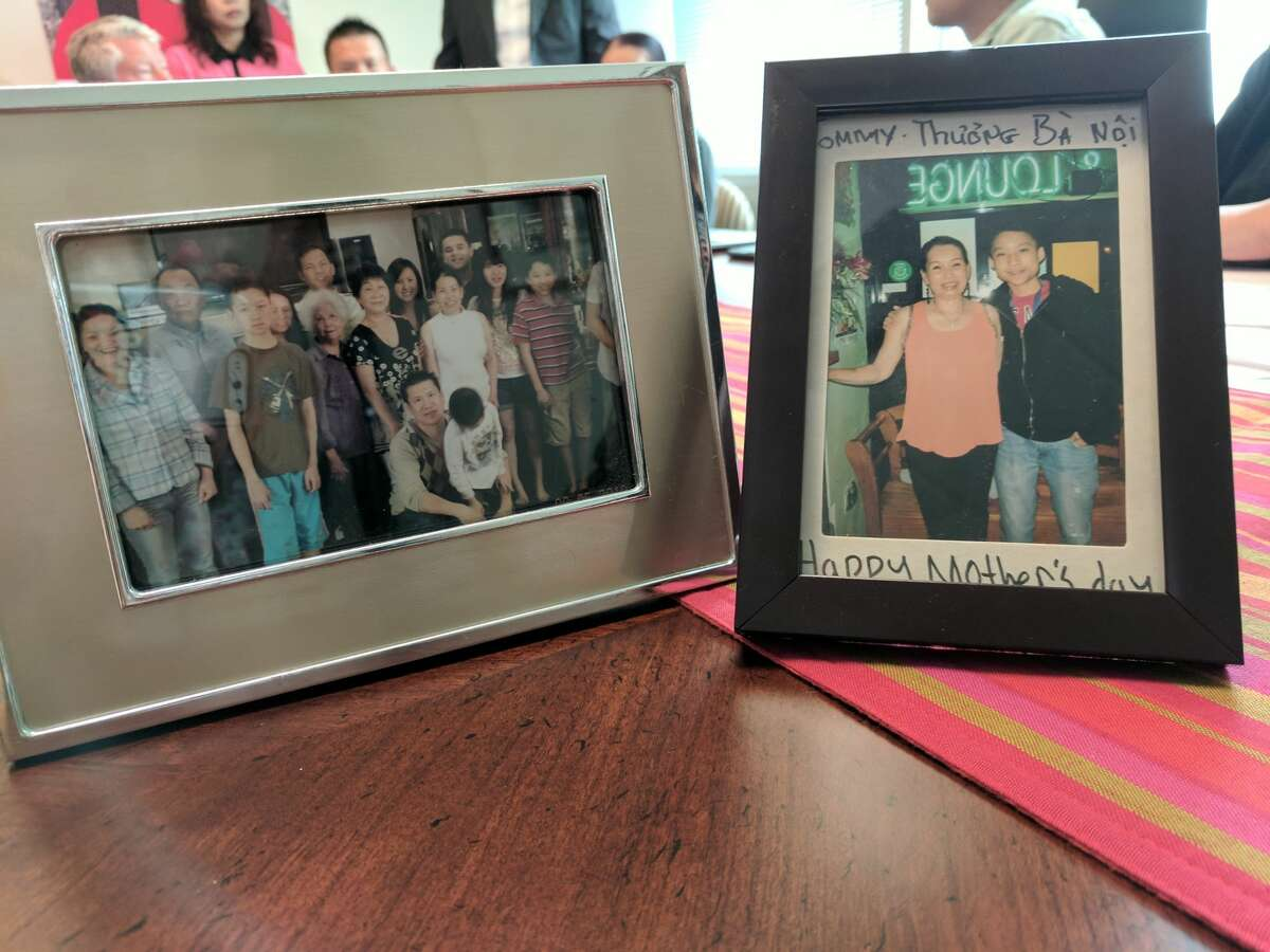 Family photos featuring Tommy Le are displayed at a Thursday morning press conference announcing his family's claim against the King County Sheriff's Office for his June death at the hands of a deputy.