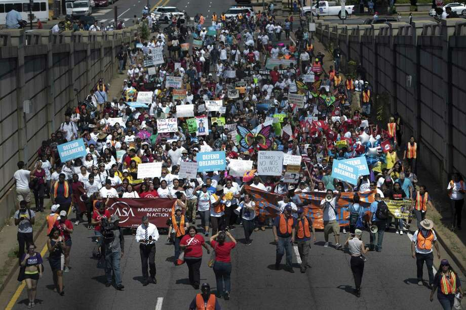 Protesters march towards the Immigration and Customs Enforcement headquarters in Washington, Tuesday. On that day, President Donald Trump ordered an end to the Obama-era executive action shielding young undocumented immigrants from deportation, urging Congress to replace it with legislation before it begins phasing out on March 5, 2018. Photo: TOM BRENNER /NYT / Internal