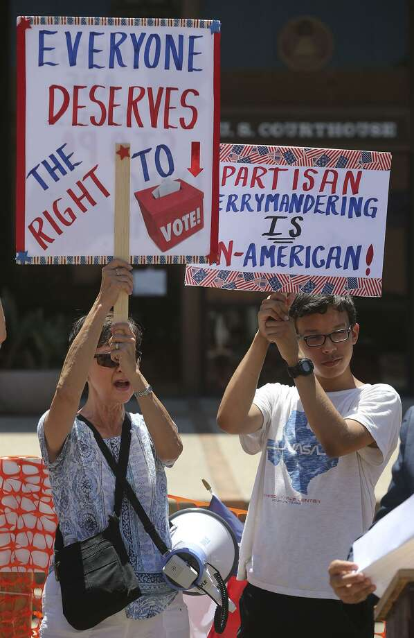 "Protesters gather July 10 outside of the John H. Wood, Jr. Federal Courthouse during a demonstration about suppression of the minority vote due to the redrawing of legislative districts. A panel of judges ultimately found ""intentional discrimination"" in some congressional and state House maps. Photo: JOHN DAVENPORT /San Antonio Express-News / ©John Davenport/San Antonio Express-News"