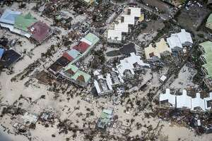 This Sept. 6, 2017 photo provided by the Dutch Defense Ministry shows storm damage in the aftermath of Hurricane Irma, in St. Maarten. Irma cut a path of devastation across the northern Caribbean, leaving thousands homeless after destroying buildings and uprooting trees. Significant damage was reported on the island that is split between French and Dutch control. (Gerben Van Es/Dutch Defense Ministry via AP)