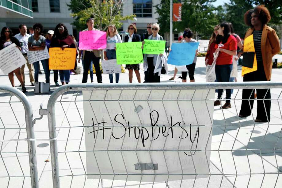 """Victims of sexual violence and their supporters gather to protest before a speech by Education Secretary Betsy DeVos, Thursday, Sept. 7, 2017, at George Mason University Arlington, Va., campus. DeVos plans to end the Obama administration's rules for investigating allegations of sexual violence on campus. DeVos said """"The era of 'rule by letter' is over,"""" as she announced plans to review and replace the way colleges and university handle investigations. (AP Photo/Jacquelyn Martin) Photo: Jacquelyn Martin, STF / Copyright 2017 The Associated Press. All rights reserved."""