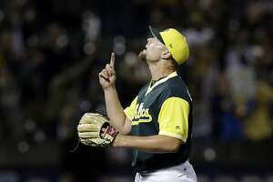 Oakland Athletics' Blake Treinen celebrates the team's 3-1 win over the Texas Rangers in a baseball game Friday, Aug. 25, 2017, in Oakland, Calif. (AP Photo/Ben Margot)