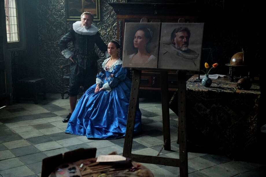 "This image released by The Weinstein Company shows Christoph Waltz, left, and Alicia Vikander in ""Tulip Fever."" (Alex Bailey/The Weinstein Company via AP) ORG XMIT: NYET858 Photo: Alex Bailey / © 2014 The Weinstein Company. All Rights Reserved."
