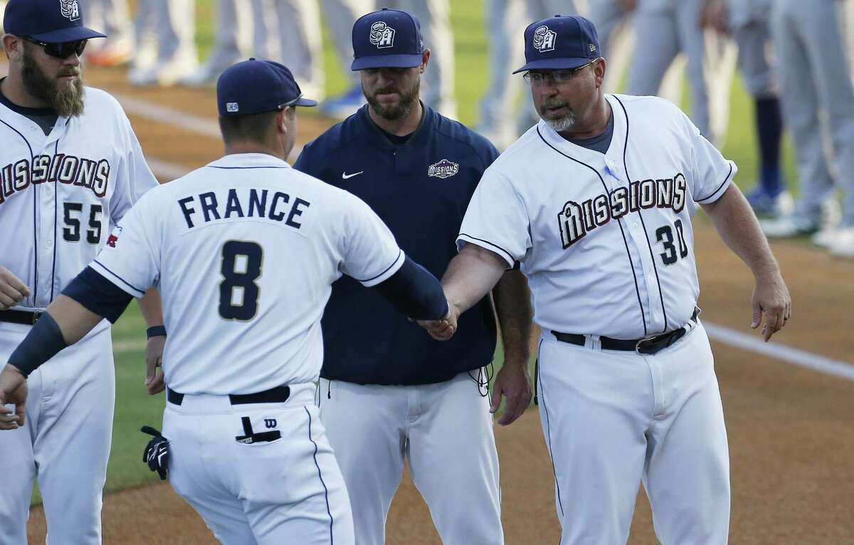 Missions manager Phillip Wellman shakes hands with Ty France (8) during player introductions before playing against the Midland RockHounds in Game 1 of the Texas League South Division championship series at Wolff Stadium on Sept. 6, 2017.