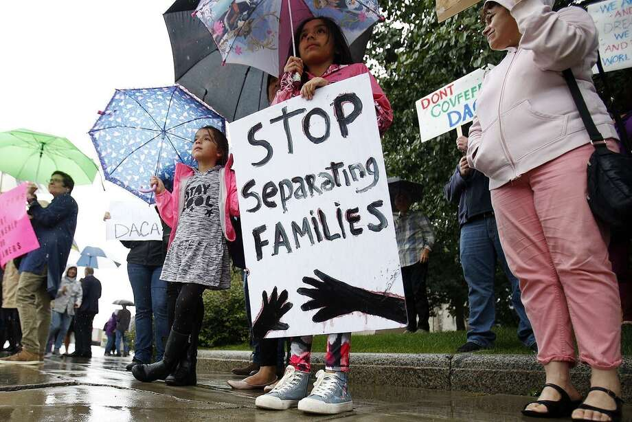 April Soasti, 9, front, and her sister Adriana, 7, stand with other community members after the president announced the plan to repeal of the Deferred Action in Childhood Arrivals (DACA) program on Tuesday. Protestors took to Park Square in Pittsfield, Mass., Thursday, Sept. 7, 2017 to speak out in support of keeping the program. (Stephanie Zollshan/The Berkshire Eagle via AP) Photo: Stephanie Zollshan, MBI / Associated Press / The Berkshire Eagle