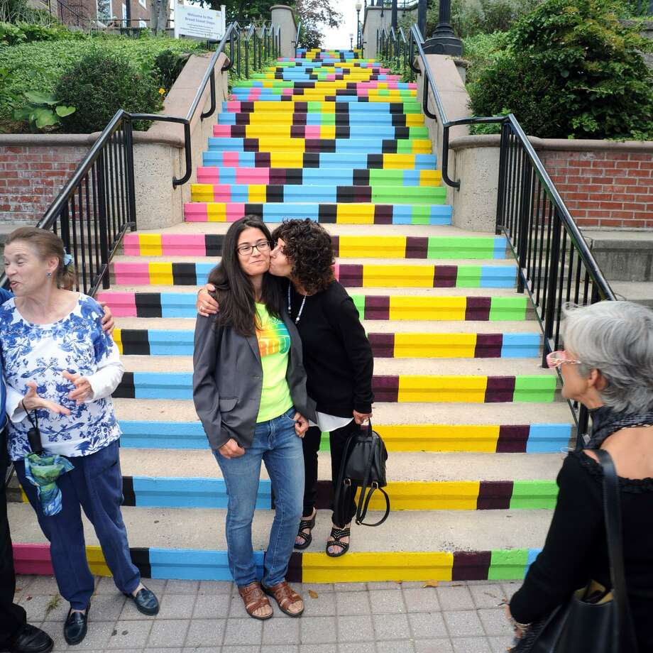 Artist Liz Squillace gets a kiss from her mother Ann during the unveiling of the newly painted Broad Street Steps in Bridgeport, Conn. Sept. 7, 2017. Squillace designed and painted the new pattern on the steps, and the unveiling was held in conjunction with an exhibition of her work at nearby City Lights Gallery. Photo: Ned Gerard / Hearst Connecticut Media / Connecticut Post