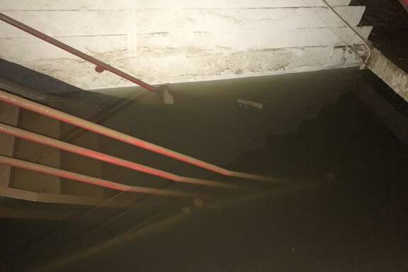 Flooded stairs in the parking garage owned by Houston First in the Theater District