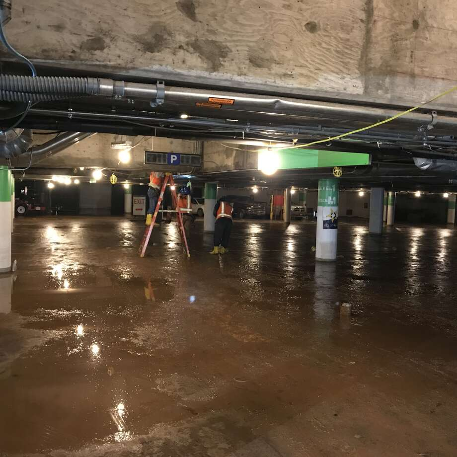 Recovery efforts are underway in Houston's Theater District parking garage.