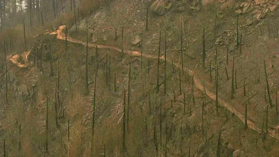 This image from video provided by KGW-TV Thursday shows fire damage to the Angel's Rest trail area in the Columbia River Gorge near Cascade Locks, Ore. The fire has scorched 52 square miles. Photo: TEL / KGW-TV