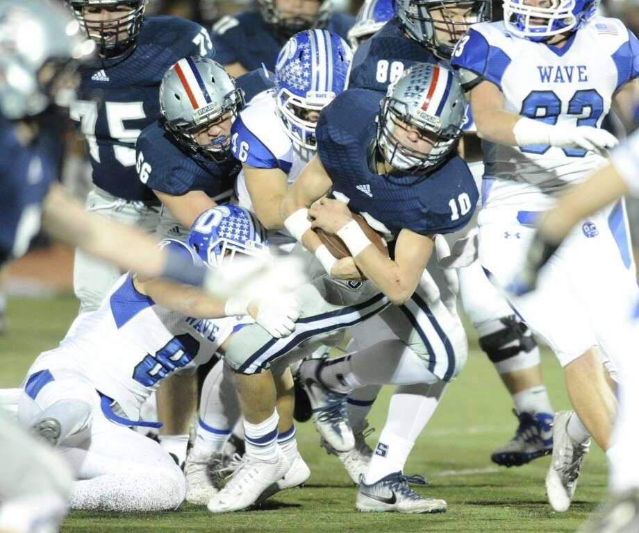 Staples' Harris Levi is pursued by the Darien defense in a Nov. 11 game at Staples. Photo: Matthew Brown / Hearst Connecticut Media / Stamford Advocate