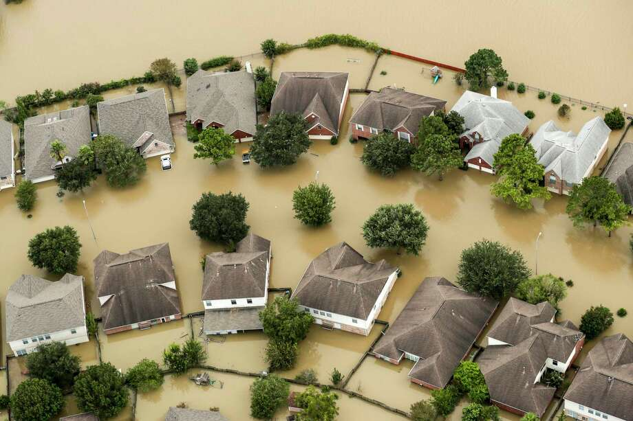 Floodwaters from the Addicks Reservoir inundate a neighborhood off N. Eldridge Parkway in the aftermath of Tropical Storm Harvey. Photo: Brett Coomer, MBO / © 2017 Houston Chronicle