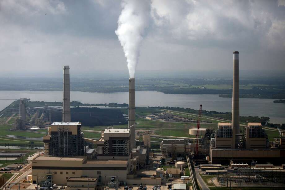 CPS Energy's coal plants, included Spruce 2, left, Spruce 1, center, and Deely are seen on Calaveras Lake in 2010. Spruce 2 construction had just been completed then. Photo: Lisa Krantz /San Antonio Express-News / SAN ANTONIO EXPRESS-NEWS