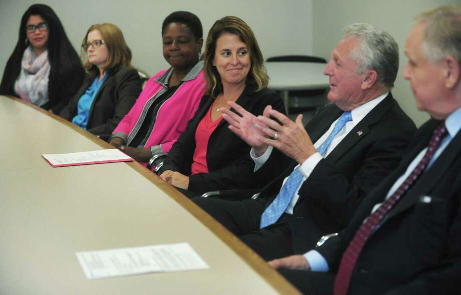 ConnCAN volunteers Katherine Villanueva and Julie Corbett, ConnCAN Community Organizer for Norwalk Toni Williams and ConnCAM CEO Jennifer Alexander listen to Norwalk Mayor Harry Rilling and Norwalk Superintendent of Schools Steven Adamowski during the release of ConnCAN's watchdog program report on the Board of Education Thursday, September 7, 2017, at City Hall in Norwalk, Conn. ConnCAN, a statewide education advocacy group, in which community volunteers attend Board of Education meetings to evaluate the board's effectiveness, transparency, civility and accountability. Photo: Erik Trautmann / Hearst Connecticut Media / Norwalk Hour