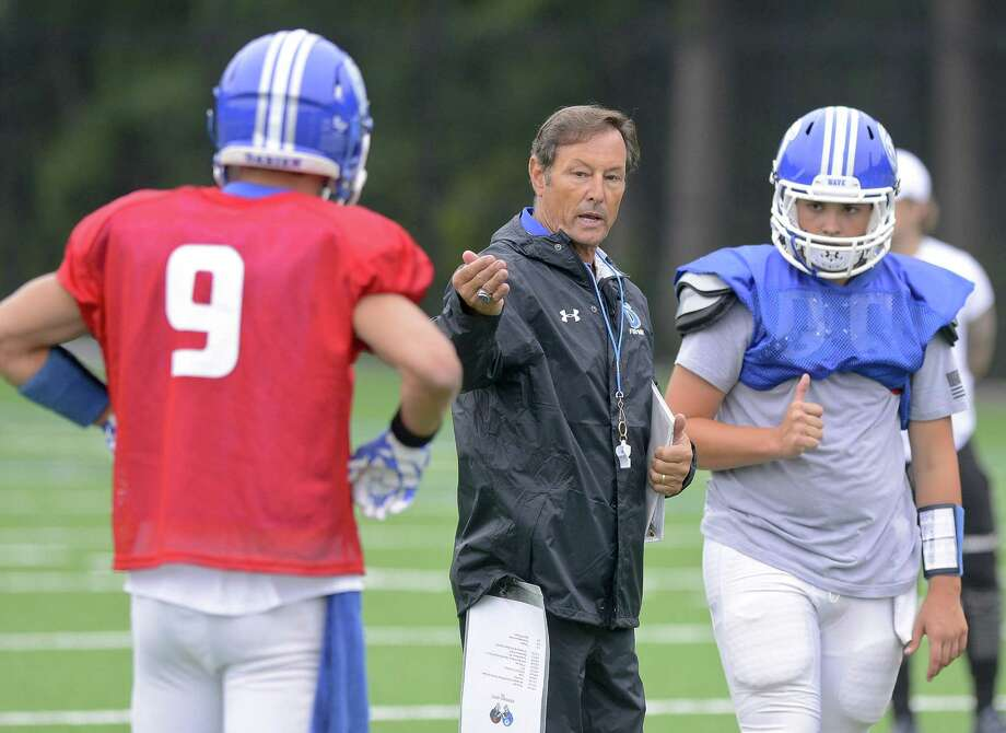 Darien football coach Rob Trifone works with his players during a team practice at Darien High School in Darein, Connecticut on Wednesday, Sept. 6, 2017. Photo: Matthew Brown / Hearst Connecticut Media / Stamford Advocate