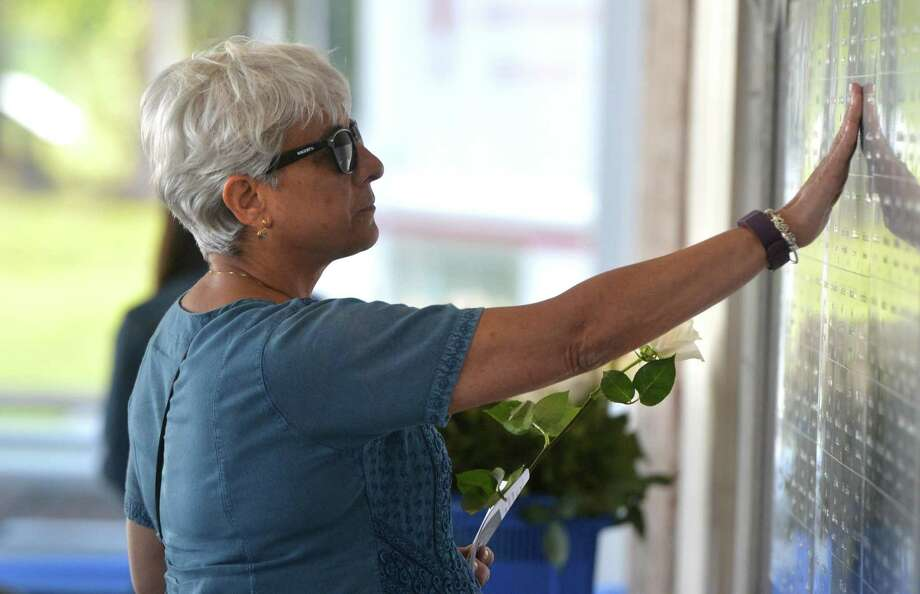 "Stamford's Donna Hughes reaches out and touches the plaque of her husband Paul, who was in Tower 1 during the terrorist attacks of Sept. 11, 2001, as she attends the state's ""September 11th Connecticut Remembers"" memorial ceremony at the 9/11 Memorial at Sherwood Island State Park on Thursday in Westport. Photo: Alex Von Kleydorff / Hearst Connecticut Media / Norwalk Hour"